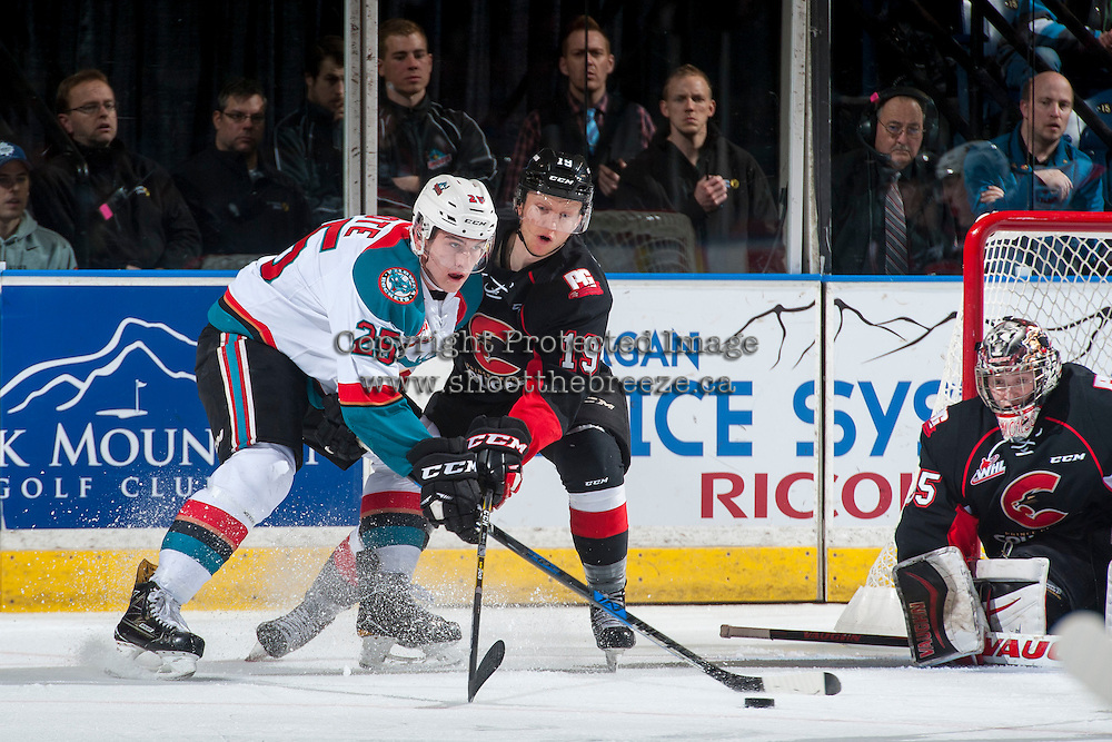KELOWNA, CANADA - MARCH 1: Cal Foote #25 of the Kelowna Rockets is checked by Shane Collins #19 of the Prince George Cougars on MARCH 1, 2017 at Prospera Place in Kelowna, British Columbia, Canada.  (Photo by Marissa Baecker/Shoot the Breeze)  *** Local Caption ***