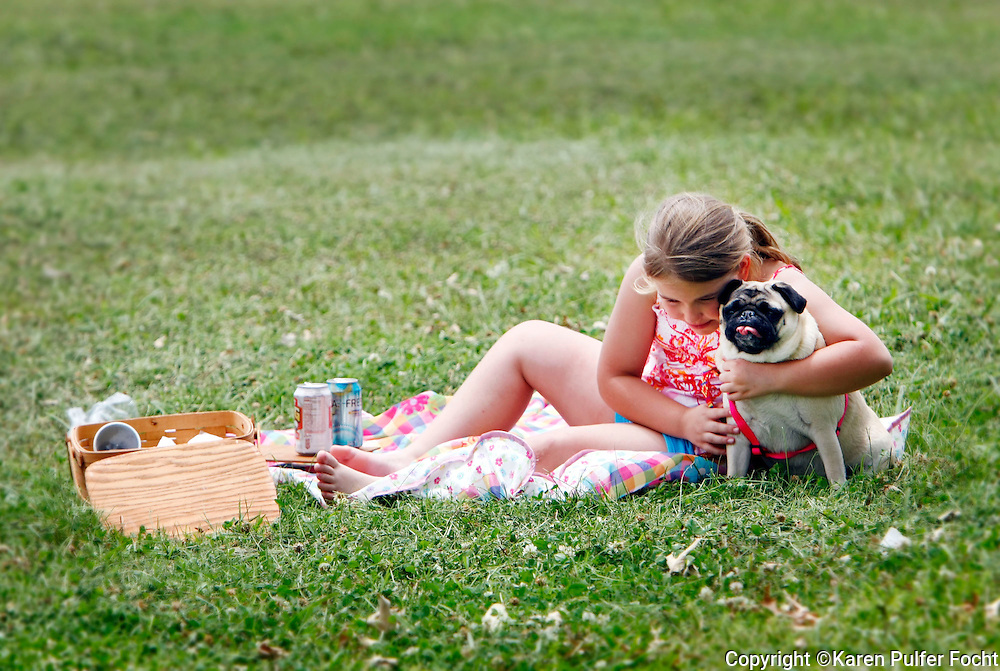 """Elli Rose Focht and her pug Peppermint during a picnic at Shelby Farms , one of the largest urban parks in the country, in Memphis, Tennessee. MSN Living's website named Memphis among the Top 20 travel destinations in the world, making it the second Top 20 ranking for Memphis this year. In December, National Geographic Traveler named the city one of the 20 """"must-see places"""" in the world."""