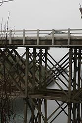 A car passes over a wooden bridge along the Mendocino coast, Mendocino, California, USA.