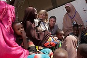 Dr. Jill Biden and Senator Bill Frist talk to a refugee family from Somalia, at the Dagahaley refugee camp, in Dadaab, Kenya, August 8, 2011. (Official White House Photo by David Lienemann)