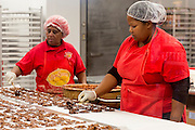 Women working at Aunt Sally's Creole Pralines factory in St Charles Avenue in New Orleans, Louisiana, USA