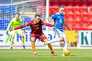 Chris Kane (#9) of St Johnstone FC shields the ball from Tom Aldred (#5) of Motherwell FC during the Ladbrokes Scottish Premiership match between St Johnstone and Motherwell at McDiarmid Stadium, Perth, Scotland on 11 May 2019.