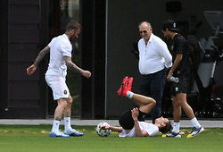 David Beckham plays football with family and friends amid coronavirus fears inside his empty Inter Miami CF stadium on what would have been the MLS home opener for his team in Ft. Lauderdale. Romeo Beckham shares PDA with his girlfriend Mia Regan while leaving the empty Inter Miami CF stadium.David Beckham poses with his boys after playing. 14 Mar 2020 Pictured: David Beckham; Romeo Beckham. Photo credit: MEGA TheMegaAgency.com +1 888 505 6342