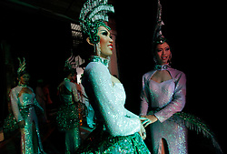 Performers wait to go on stage during the Tiffany Show in Pattaya, Thailand 08 April 2009. The Tiffany show is one of the biggest transvestite cabaret show in Thailand with about 80 to 100 performers performing three shows every night for the past 33 years. Pattaya, a tourist hotspot known as a sex and entertainment city will host the ASEAN plus three and six summits including leaders of China, Japan, South Korea, India, Australia, and New Zealand, with South East Asian leaders from 10 to 12 April.