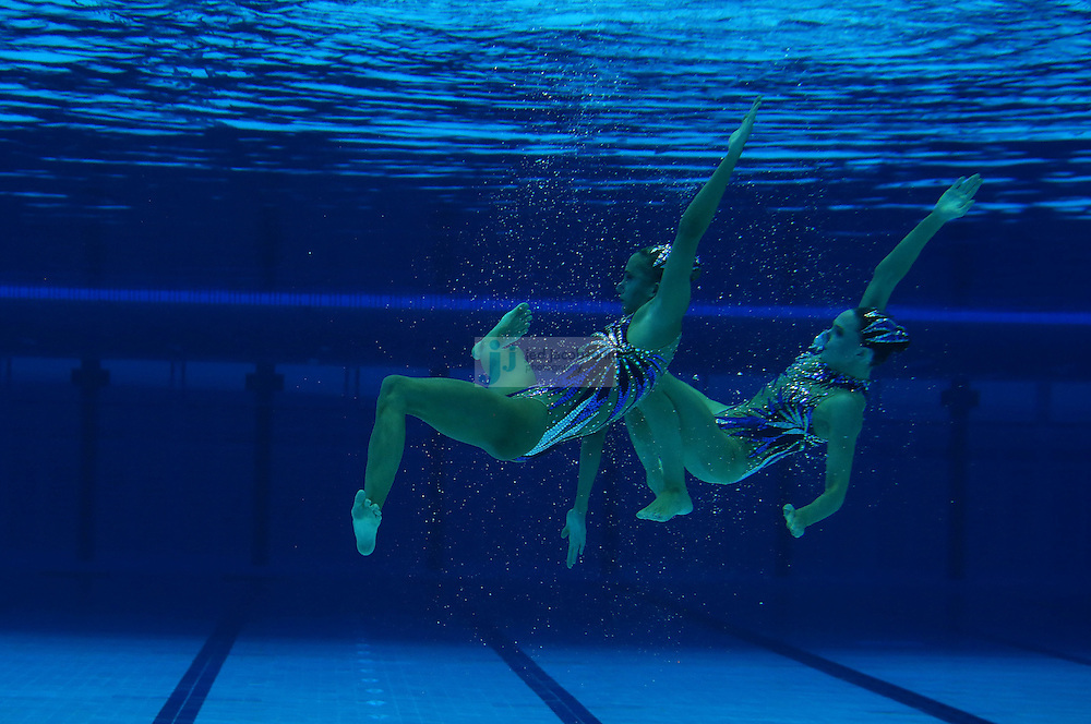 Olivia Federici and Jenna Randall of Great Britain compete during the women's duet synchronized swimming at the Olympic Stadium during day 10 of the London Olympic Games in London, England, United Kingdom on August 3, 2012..(Jed Jacobsohn/for The New York Times)..