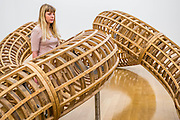 Tate Britain launches its major spring show, exhibiting the work of Turner Prize-winning artist Richard Deacon (b.1949). It includes large sculptures made of twisted wood, metal, and ceramic such as: Fold 2012, a towering sculpture weighing over 12 tonnes and made of 60 shimmering glazed ceramic bricks; After 1998, a huge serpentine wooden structure that is over 9 metres at its longest point (pictured); and Out of Order 2003, a sprawling sculpture constructed from ribbons of steamed wood. The Tate Britain, London, UK 03 February 2014. Guy Bell, 07771 786236, guy@gbphotos.com