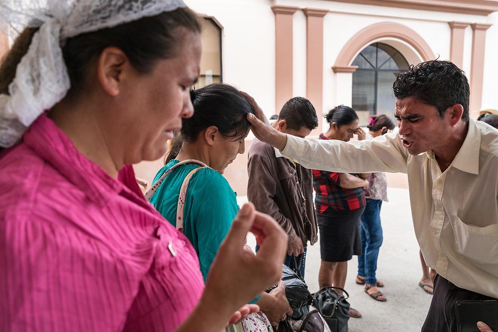 Daniel Vasquez Cortez, 28, preaches the gospel at the front entrance of Occidente Hospital in Santa Rosa de Copan, Copan, Honduras on Feb. 11, 2017. Cortez preaches there about every other Saturday. Photo Ken Cedeno