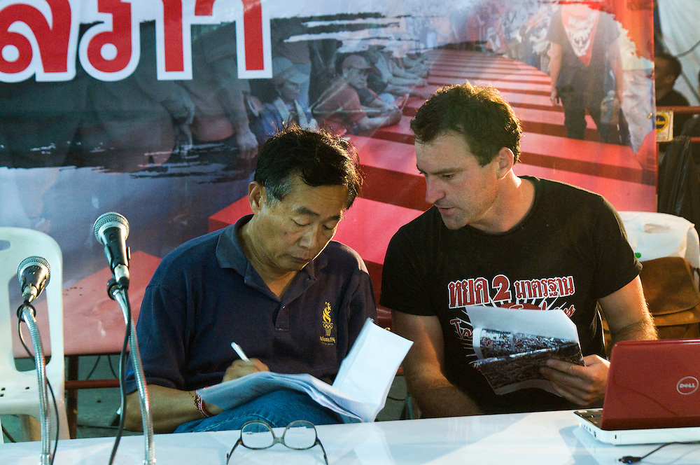 Australian, Connor Purcell (right), with red shirt protest leader Weng Tochirakarn preparing back stage before giving his 3rd speech to a large audience at the main Ratchaprasong protest stage, Bangkok, Thailand on April 27, 2010.