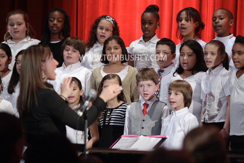 Middletown, NY -  A music teacher conducts the chorus during the Mechanicstown Elementary School winter concert on Dec. 9, 2008.