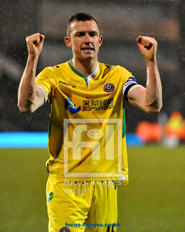 Picture by Alan Stanford/Focus Images Ltd +44 7915 056117<br /> 04/02/2014<br /> Neil Collins of Sheffield United celebrates their win in the The FA Cup match at Craven Cottage, London