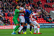 Tom Nichols of Bristol Rovers is fouled in the box penalty given to Bristol Rovers during the EFL Sky Bet League 1 match between Doncaster Rovers and Bristol Rovers at the Keepmoat Stadium, Doncaster, England on 19 October 2019.