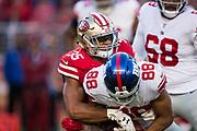 San Francisco 49ers strong safety Eric Reid (35) tackles New York Giants tight end Evan Engram (88) at Levi's Stadium in Santa Clara, Calif., on November 12, 2017. (Stan Olszewski/Special to S.F. Examiner)