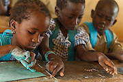 Children write on their slates during class at the Faye primary school in the town of Faye, Bas-Sassandra region, Cote d'Ivoire on Monday March 5, 2012. The class has 79 students, and the school has been forced to refuse any additional students.