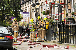 A fire broke out at the Nira Caledonia Hotel on Gloucester Road in  Edinburgh's New Town. Fire Engines were called at 14:50 after workmen on the roof of the hotel reported a fire.