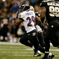 Nov 24, 2014; New Orleans, LA, USA; Baltimore Ravens running back Justin Forsett (29) runs against the New Orleans Saints during the first quarter of a game at the Mercedes-Benz Superdome. The Ravens defeated the Saints 34-27. Mandatory Credit: Derick E. Hingle-USA TODAY Sports