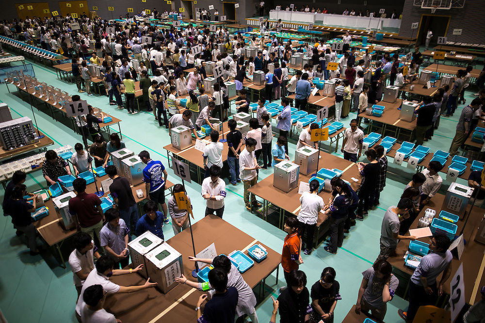 TOKYO, JAPAN - JULY 10 : Election staff members ready before the counting begin for the Parliament's upper house elections at a ballot counting center in Shinjuku Cosmic Sports Center in Shinjuku-ku on Sunday, July 10, 2016 in Tokyo, Japan. (Photo by Richard Atrero de Guzman/NUR Photo)