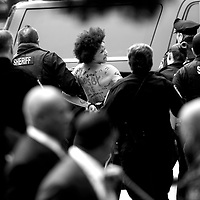 NORRISTOWN, PA - APRIL 9: A topless protestor wearing body paint is arrested by police officers at the Montgomery County Courthouse on the first day of Bill Cosby's sexual assault retrial on April 9, 2018 in Norristown, Pennsylvania. A former Temple University employee alleges that the entertainer drugged and molested her in 2004 at his home in suburban Philadelphia. Sixty women have accused the 80 year old entertainer of sexual assault. (Photo by Mark Makela/Getty Images)