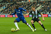 Ngolo Kante (#7) of Chelsea steers the ball away from the pressure being applied by Matt Ritchie (#11) of Newcastle United during the Premier League match between Newcastle United and Chelsea at St. James's Park, Newcastle, England on 18 January 2020.