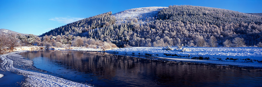 A frozen River Tweed passing through Innerleithen with Cadon Bank in the backgrouind in the depths of a freezing winter.