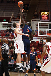 November 18, 2010; Stanford, CA, USA;  Virginia Cavaliers center Assane Sene (5) wins the opening tip off from Stanford Cardinal forward Jack Trotter (50) during the first half at Maples Pavilion.