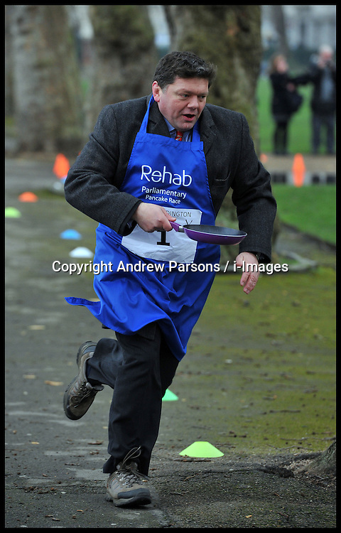 MP's and Lords race against political Journalist in the Rehab Parliamentary Pancake Shrove Tuesday race a charity event which sees MPs and Lords joined by media types in a race to the finish. Victoria Tower Gardens, Westminster, Tuesday February 12, 2013. Photo By Andrew Parsons / i-Images