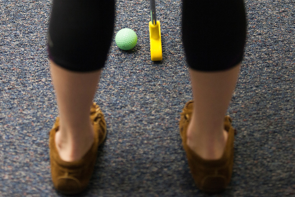Abigail Spriggs putts a golf ball during the Alden Open, a Dad's Weekend Mini-Golf event in Alden Library, on Saturday, November 7, 2015. Photo by Kaitlin Owens