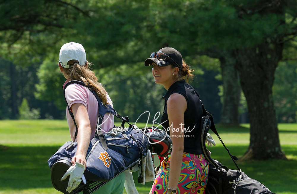 Cydney Clanton and Kim Kaufman walk towards the green during Saturday's round of the Symetra LPGA Tour at Beaver Meadow Golf Course.  (Karen Bobotas/for the Concord Monitor)