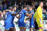 Celebrates scoring Bayo Akinfenwa of AFC Wimbledon equalises during the Sky Bet League 2 match between Yeovil Town and AFC Wimbledon at Huish Park, Yeovil, England on 12 September 2015. Photo by Stuart Butcher.