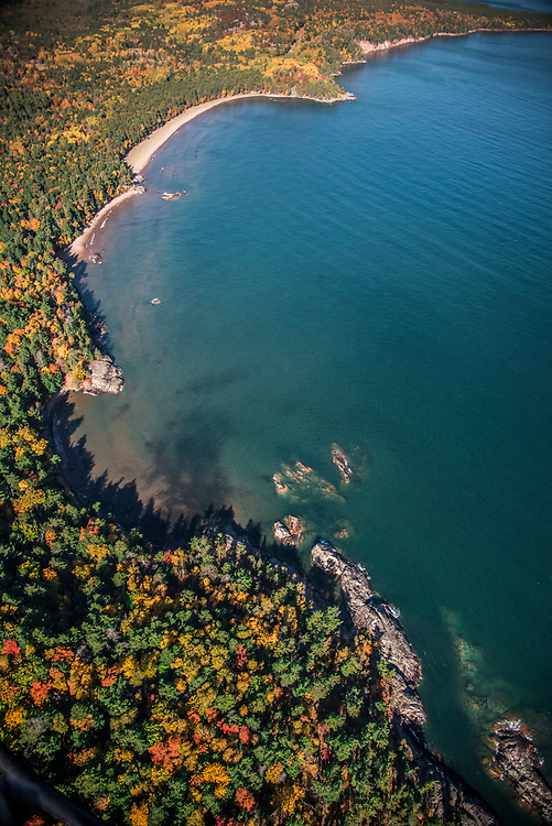 Aerial photography of  the rugged Lake Superior shoreline north of Marquette, Michigan during fall color season. Areas shown include Wetmore Landing Beach.