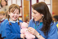 22/02/2014 Sophie Nolan Scoil Caithriona with Katie Lynam  2nd Med at the 10th annual Teddy Bear Hospital at NUI Galway will take place Thursday and Friday, 22 and 23 January. The event will see over 1,500 sick teddy bears admitted to the hospital, accompanied by their minders, 1,500 primary school children.<br /> <br /> The event is organised by the Sl&aacute;inte Society, the NUI Galway branch of the International Federation of Medical Students Associations, and up to 200 medical and science students will diagnose and treat the teddy bears. In the process, they hope to help children, ranging in age from 3-8 years, feel more comfortable around doctors and hospitals.. Photo:Andrew Downes