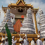 Royal Cambodian Guards and Buddhist monks move the body of former Cambodian King Norodom Sihanouk as others look on during funeral services Friday Feb. 1, 2013 in Phnom Penh, Cambodia.   The royal cremation ceremony for former Cambodian King Norodom Sihanouk is scheduled on 04 February 2013, after he died on 15 October 2012 in Beijing, China, at the age of 89..