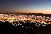 El Paso and Cd. Juarez at night from the top of Mount Franklin, Wyler Tramway State Park, Texas.