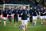 Peterborough United midfielder Alex Woodyard (4) leads the Posh team in the warm up before the EFL Sky Bet League 1 match between Wycombe Wanderers and Peterborough United at Adams Park, High Wycombe, England on 3 November 2018.
