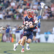 Brent Adams #28 of the Boston Cannons keeps the ball from a Charlotte Hounds defenderduring the game at Harvard Stadium on May 17, 2014 in Boston, Massachuttes. (Photo by Elan Kawesch)