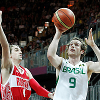 02 August 2012: Brazil Marcelinho Huertas goes for the floater against Russia Alexey Shved during 75-74 Team Russia victory over Team Brazil, during the men's basketball preliminary, at the Basketball Arena, in London, Great Britain.
