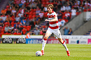 Tom Anderson of Doncaster Rovers (4) in action during the EFL Sky Bet League 1 match between Doncaster Rovers and Gillingham at the Keepmoat Stadium, Doncaster, England on 3 August 2019.