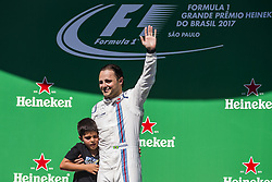 November 12, 2017 - Sao Paulo, Sao Paulo, Brazil - Nov, 2017 - Sao Paulo, Sao Paulo, Brazil - In the photo the Brazilian pilot FELIPE MASSA / Williams next to his son, says goodbye to the fans since this will be his last season in the competition. German driver SEBASTIAN VETTEL/Scuderia Ferrari won the Brazilian Formula One Grand Prix on Sunday at the Interlagos autodromo in Sao Paulo. VALTTERI BOTTAS/Mercedes AMG was second place, followed by filipinos KIMI RAIKKONEN/Scuderia Ferrari. (Credit Image: © Marcelo Chello via ZUMA Wire)
