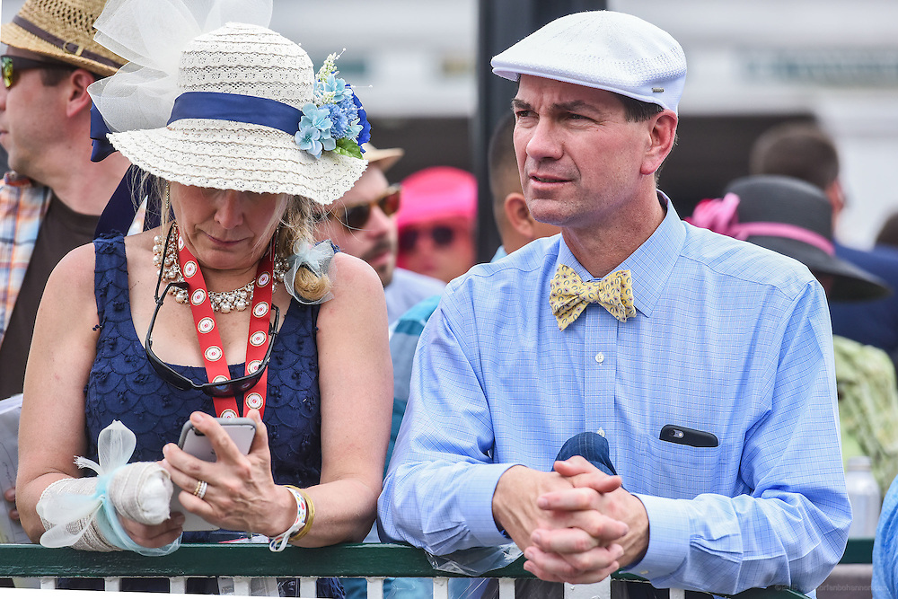 Kathleen and Peter Podurgiel of Boston, Mass., watch horses enter the paddock at the 142nd running of the Kentucky Derby. May 7, 2016