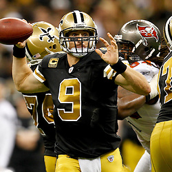 November 6, 2011; New Orleans, LA, USA; New Orleans Saints quarterback Drew Brees (9) throws against the Tampa Bay Buccaneers during the second quarter of a game at the Mercedes-Benz Superdome. Mandatory Credit: Derick E. Hingle-US PRESSWIRE