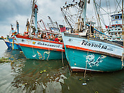 01 OCTOBER 2015 - MAHACHAI, SAMUT SAKHON, THAILAND:  Thai fishing trawlers in port in Mahachai, one of Thailand's largest fishing ports. Thailand's fishing industry had been facing an October deadline from the European Union to address issues related to overfishing and labor practices. Failure to adequately address the issues could have resulted in a ban on Thai exports to the EU. In September Thai officials announced that they had secured an extension of the deadline. Officials did not say how much extra time they had to meet the EU goals. Thailand's overall annual exports to the EU are between 23.2 billion Thai Baht and 30 billion Thai Baht (US$645 million to US $841 million). Thailand's total fish exports were worth about 110 billion baht in 2014.    PHOTO BY JACK KURTZ
