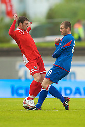 REYKJAVIK, ICELAND - Wednesday, May 28, 2008: Wales' Jason Koumas in action against Iceland's Stefan Thordarson during the international friendly match at the Laugardalsvollur Stadium. (Photo by David Rawcliffe/Propaganda)