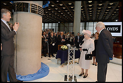 HM The Queen unvails a plaque in the Lloyds of London building in the City of London, with The Chairman of Lloyds of London John Nelson, Thursday, 27th March 2014. Picture by Andrew Parsons / i-Images