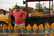 A roadside vendors sells oranges by his truck in Atibaia, Brazil.