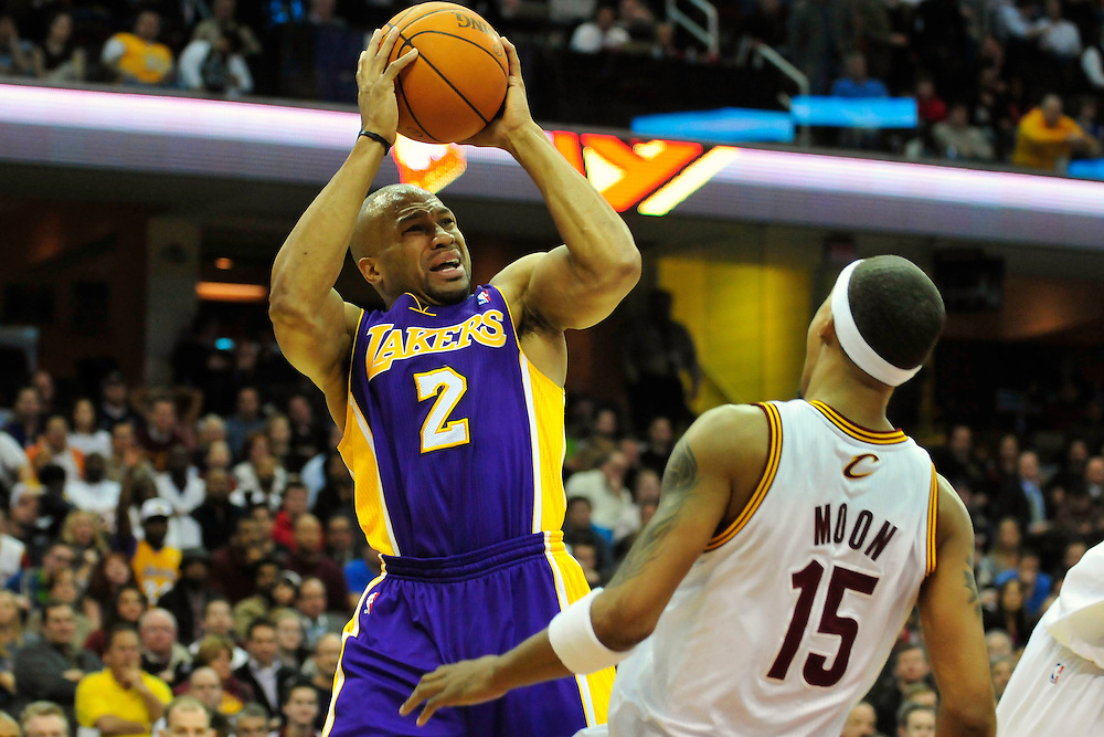 Feb. 16, 2011; Cleveland, OH, USA; Los Angeles Lakers point guard Derek Fisher (2) passes over Cleveland Cavaliers small forward Jamario Moon (15) during the fourth quarter at Quicken Loans Arena. The Cavaliers beat the Lakers 104-99. Mandatory Credit: Jason Miller-US PRESSWIRE