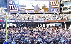 Feb 7, 2012; East Rutherford, NJ, USA; New York Giants quarterback Eli Manning (10) carries the Vince Lombardi Trophy onto the field during the New York Giants Super Bowl XLVI Rally at MetLife Stadium.
