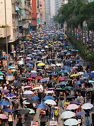Hong Kong. 29 September, 2019. Illegal march by thousands of pro-democracy supporters from Causeway Bay to Government offices at Admiralty. Police unsuccessfully tried to stop march at start with teargas fired and scuffles. March marked the 5th anniversary of the start of the Umbrella Movement.