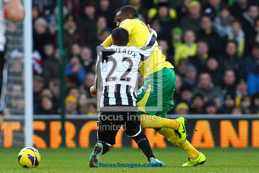 Picture by Paul Chesterton/Focus Images Ltd +44 7904 640267.12/01/2013.Sylvain Marveaux of Newcastle and Sebastien Bassong of Norwich in action during the Barclays Premier League match at Carrow Road, Norwich.