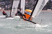 David Shaw (NZL270) rounds the top mark in race seven of the A Class World championships regatta being sailed at Takapuna in Auckland. 15/2/2014