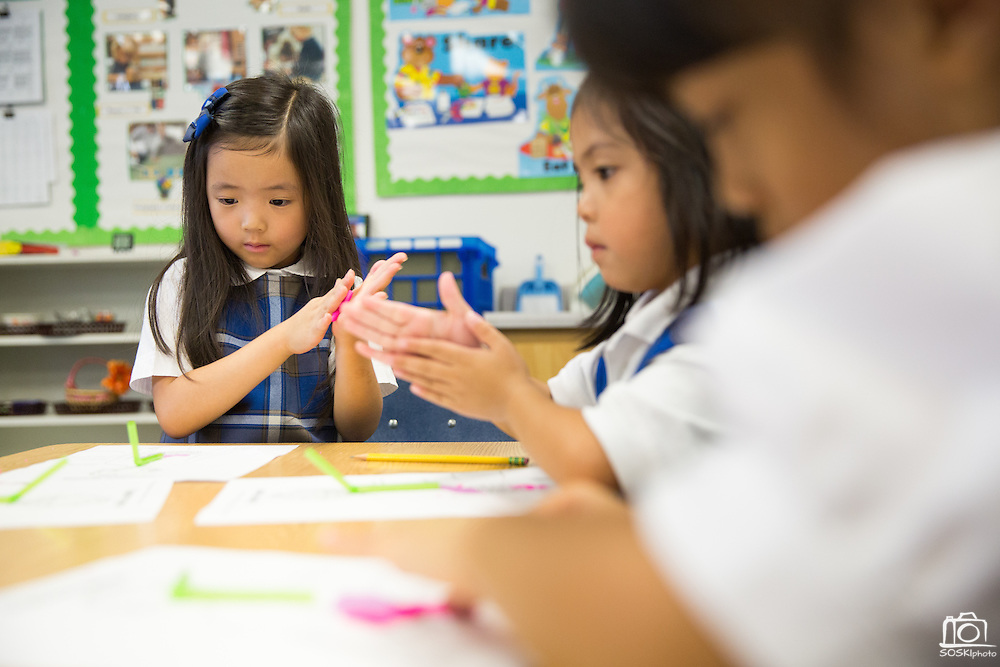 Students perform activities in groups and individually at Monarch Christian Preschool & Kindergarten in Milpitas, California, on September 12, 2014. (Stan Olszewski/SOSKIphoto)