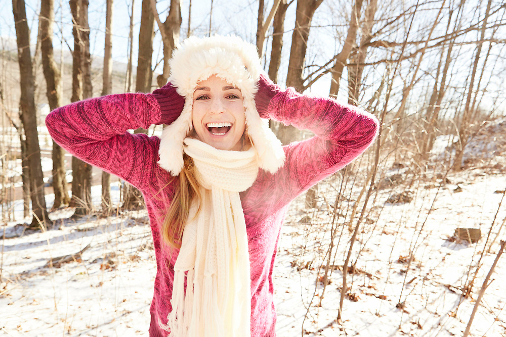 Lifestyle image of teen girl having fun in snow mountain
